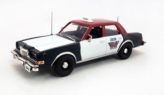 "1:43 1985 Dodge Diplomat ""Chicago Taxi"" (Red/White/Blue)"