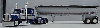 1:64 Peterbilt 389 Flattop Sleeper w/MAC Half-Round Dump Trailer (Blue/Silver)