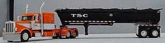 "1:64 Peterbilt 389 Flattop Sleeper w/MAC Half-Round Dump Trailer ""TSC"" (Orange/White)"