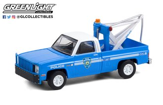 "1:64 1987 GMC Sierra K2500 with Drop in Tow Hook -  ""New York City Police Dept (NYPD)"""