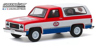 "1:64 Blue Collar Collection Series 7 - 1990 GMC Jimmy ""STP"""