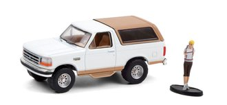 """1:64 The Hobby Shop Series 10 - 1996 Ford Bronco """"Eddie Bauer"""" w/Backpacker (White/Light Saddle)"""