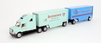 """Ford AeroMax Louisville Sleeper w/Double Pup Skirted Trailers (2) """"Interstate/Global Merger"""""""